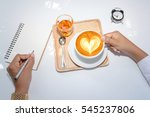 businessman holding a cup of... | Shutterstock . vector #545237806