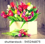 tulips in the box on wooden... | Shutterstock . vector #545246875