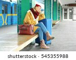woman waiting at the railway... | Shutterstock . vector #545355988