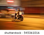 man on scooter speeding through ... | Shutterstock . vector #545361016