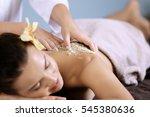 young woman receiving scrub...   Shutterstock . vector #545380636