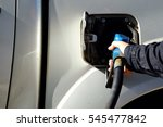 hand holding nozzle fuel on... | Shutterstock . vector #545477842