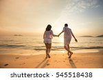 couple hand by hand at sunset.... | Shutterstock . vector #545518438