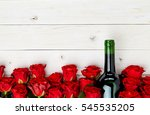 Buds Of Red Roses And Bottle Of ...
