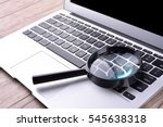 laptop computer with magnifying ... | Shutterstock . vector #545638318