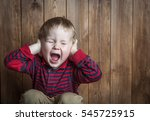 cute boy shouts covered his... | Shutterstock . vector #545725915