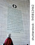 Small photo of A woman reading the words of Abraham Lincoln.