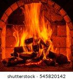 a fire burns in a fireplace. | Shutterstock . vector #545820142