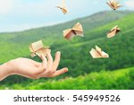 Female Hand And Flying Books O...