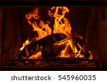 Log Fire In A Fireplace.