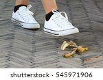woman stepping on banana skin... | Shutterstock . vector #545971906