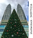 Small photo of Kuala Lumpur, December 2016. Tallest Christmas tree replica in Malaysia on display at KLCC Esplanade during the festive season. The tree was acknowledged by the Malaysia Book of Records.