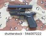 Disassembled Pistol Isolated O...