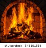 a fire burns in a fireplace. | Shutterstock . vector #546101596