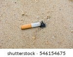 Cigarette On Sand Beach...