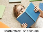 cute little girl reading book... | Shutterstock . vector #546234808
