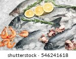 frozen fish and seafood on ice | Shutterstock . vector #546241618