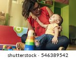 child boy and mother playing... | Shutterstock . vector #546389542