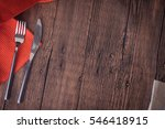 Fork And Knife On Wooden Table...