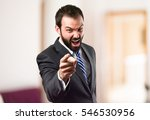 businessman angry and shouting... | Shutterstock . vector #546530956