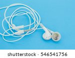 Small photo of ear bud or ear phone on blue background