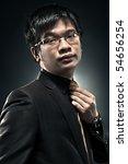 Young japan businessman portrait. Contrast colors. - stock photo