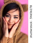 Young japan woman in bear suit. Selective focus effect. - stock photo