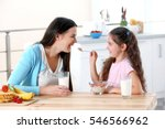 mother and daughter having... | Shutterstock . vector #546566962