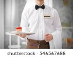 waiter in white shirt bringing... | Shutterstock . vector #546567688