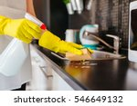 woman cleaning kitchen cabinets ... | Shutterstock . vector #546649132