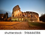 Small photo of Night view of Colosseum in Rome, Italy. Rome architecture and landmark. Rome Colosseum is one of the main attractions of Rome and Italy