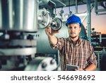 man wearing blue hardhat using... | Shutterstock . vector #546698692