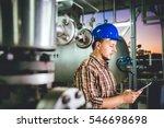 man wearing blue hardhat using...   Shutterstock . vector #546698698