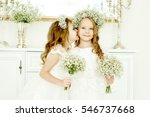 Two little girls in wedding...