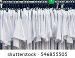 white t shirt on rack in market | Shutterstock . vector #546855505
