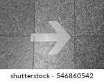 arrow sign on ground