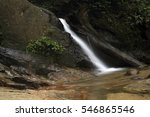 Small photo of A beautiful Kanching Waterfall in Malaysia. A Soft silky water flow affect obtain from slow shutter speed with tropical green forest and rock cover with moss