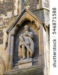 Small photo of A statue of king Harold on the exterior of Waltham Abbey Church in Waltham Abbey, Essex. King Harold II died at the Battle of Hastings in 1066 and is said to be buried in the churchyard.