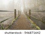 Crossing A Footbridge Over A...