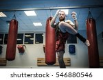 Small photo of Fighter shadowboxing at gym