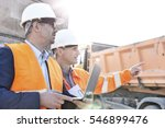 supervisor showing something to ... | Shutterstock . vector #546899476