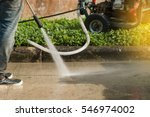 worker cleaning driveway with... | Shutterstock . vector #546974002
