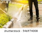 worker cleaning driveway with ... | Shutterstock . vector #546974008