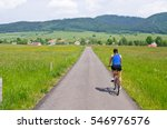 Young Woman Cycling In The...