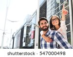smiling woman pointing away... | Shutterstock . vector #547000498