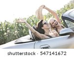 excited female friends enjoying ... | Shutterstock . vector #547141672