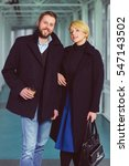 elegant couple dressed in coat... | Shutterstock . vector #547143502