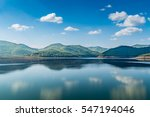 lake with mountain on blue sky... | Shutterstock . vector #547194046