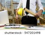 engineer hold security helmet... | Shutterstock . vector #547201498