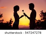 Man Giving Woman A Rose....